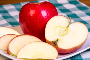 red apple and apple slices on a plate