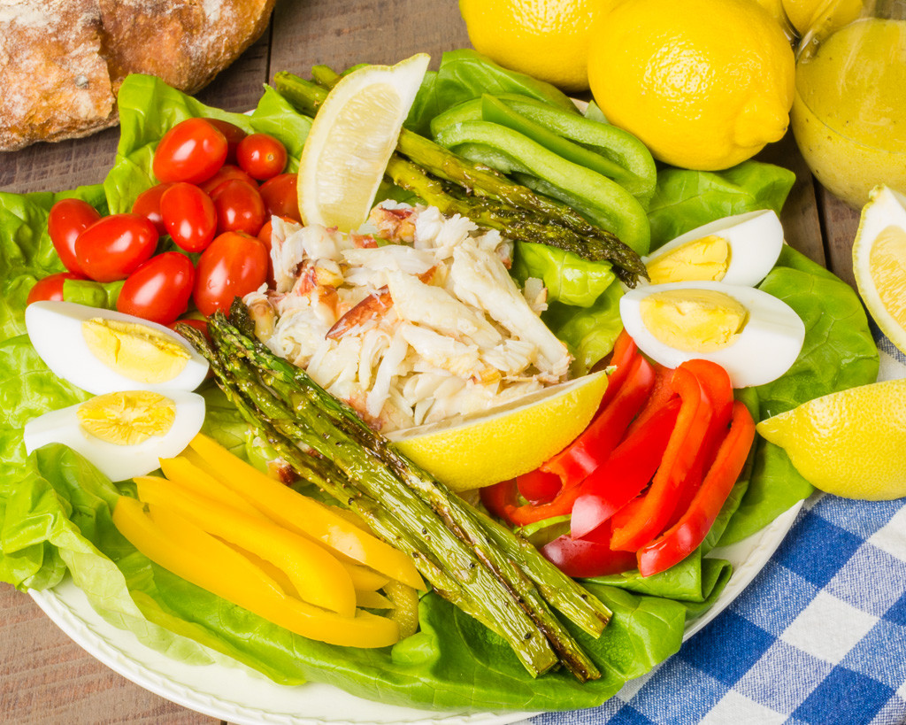 Fresh crab salad with asparagus and lemons and loaf of bread