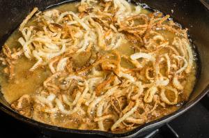 Onions frying in pan