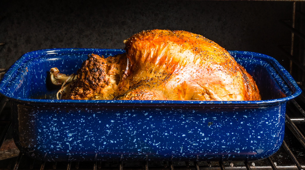 Roasted turkey in blue roasting pan