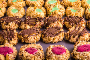 Rows of thumbprint cookies with nuts